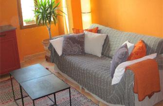 Maison Jaune - Vue du Salon avec canapé lit